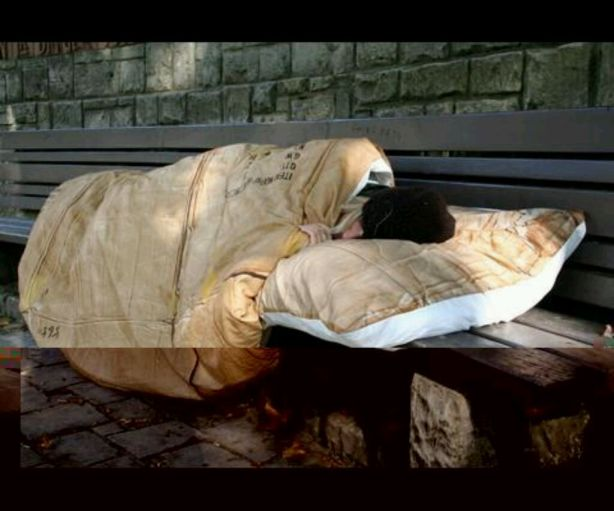 Homeless person, sleeping comfortable on a bench!